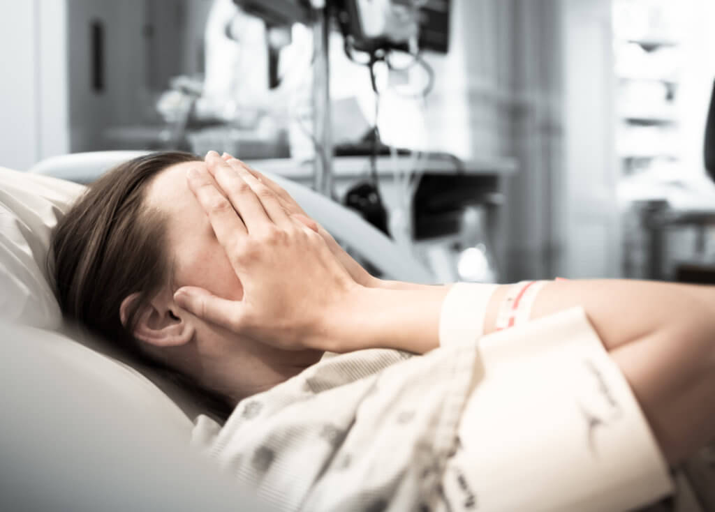 Worried patient in hospital bed